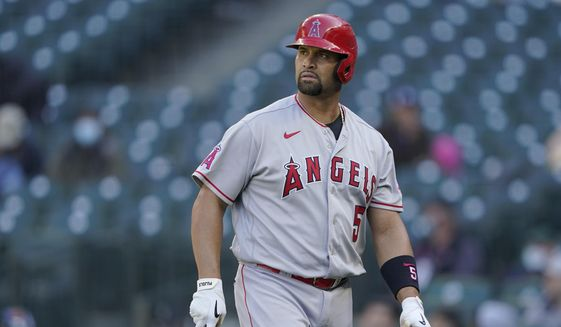 Los Angeles Angels Albert Pujols walks to the dugout after he was called out on strikes during the ninth inning of a baseball game against the Seattle Mariners, Sunday, May 2, 2021, in Seattle.  (AP Photo/Ted S. Warren) **FILE**
