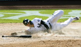 New York Yankees' Gleyber Torres slides home to score on a single by Aaron Hicks in the eight inning of a baseball game against the Houston Astros, Thursday, May 6, 2021, at Yankee Stadium in New York. The Astros defeated the New York Yankees 7-4. (AP Photo/Kathy Willens)