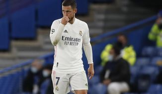 Real Madrid's Eden Hazard gestures after Chelsea's Mason Mount scored his side's second goal, during the Champions League semifinal 2nd leg soccer match between Chelsea and Real Madrid at Stamford Bridge in London, Wednesday, May 5, 2021. (AP Photo/Alastair Grant)