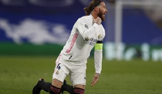 Real Madrid's Sergio Ramos gestures during the Champions League semifinal 2nd leg soccer match between Chelsea and Real Madrid at Stamford Bridge in London, Wednesday, May 5, 2021. (AP Photo/Alastair Grant)
