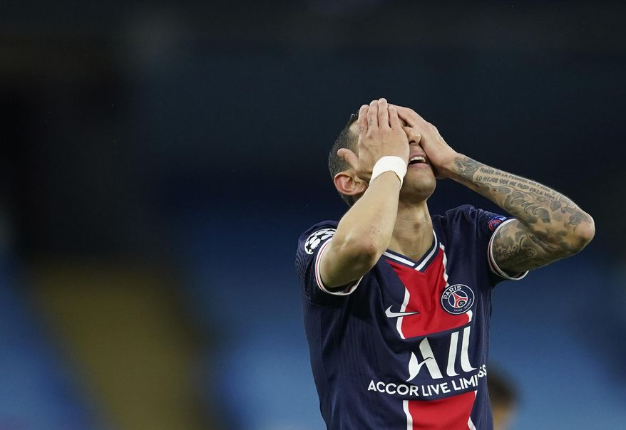 PSG's Angel Di Maria gesture after missing a chance during the Champions League semifinal second leg soccer match between Manchester City and Paris Saint Germain at the Etihad stadium, in Manchester, Tuesday, May 4, 2021. (AP Photo/Dave Thompson)