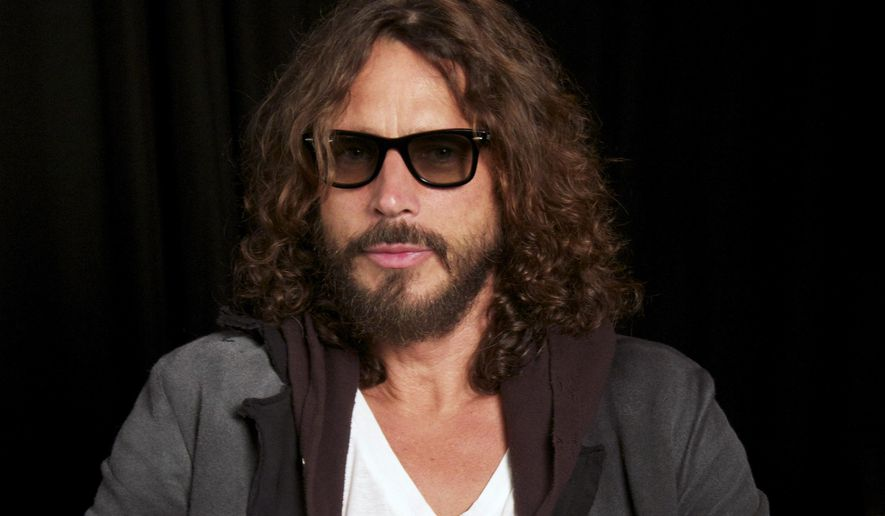 The family of Chris Cornell and a doctor who they alleged over-prescribed him drugs before he died have agreed to a settle a lawsuit.  (AP Photo/John Carucci, File)
