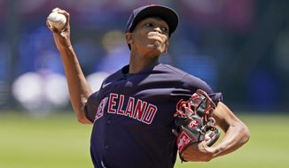 Cleveland Indians starting pitcher Triston McKenzie throws during the first inning of a baseball game against the Kansas City Royals Thursday, May 6, 2021, in Kansas City, Mo. (AP Photo/Charlie Riedel)