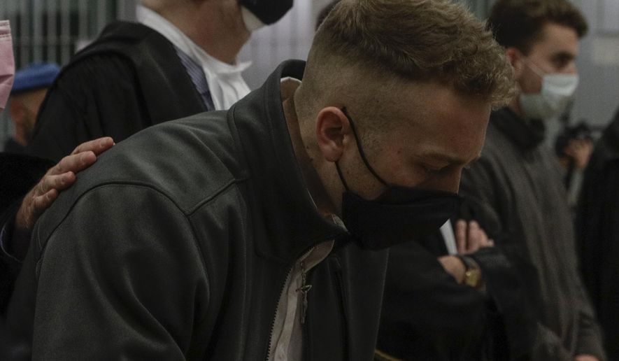 Finnegan Lee Elder and his co-defendant Gabriel Natale-Hjorth, right, listen as the verdict is read, in the trial for the slaying of an Italian plainclothes police officer on a street near the hotel where they were staying while on vacation in Rome in summer 2019, in Rome, Wednesday, May 5, 2021. A jury in Rome on Wednesday convicted two American friends in the 2019 slaying of a police officer in a drug sting gone awry, sentencing them to life in prison. The jury deliberated more than 12 hours before delivering the verdicts against Finnegan Lee Elder, 21, and Gabriel Natale Hjorth, 20, handing them Italy's stiffest sentence. (AP Photo/Gregorio Borgia)