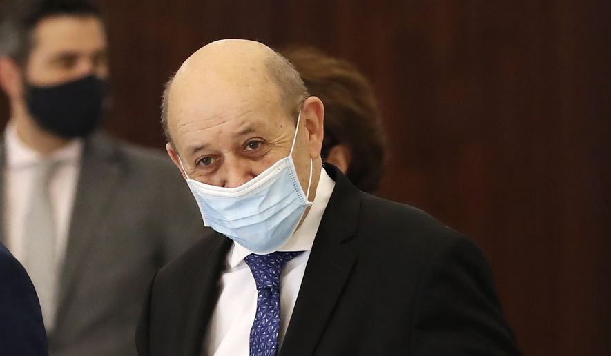 French Foreign Minister Jean-Yves Le Drian, leaves the Presidential Palace after his meeting with Lebanese President Michel Aoun in Baabda, east of Beirut, Lebanon, Thursday, May 6, 2021. (AP Photo/Hussein Malla) ** FILE **