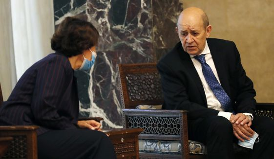 French Foreign Minister Jean-Yves Le Drian, right, speaks with the French Ambassador to Lebanon Anne Grillo, left, during his meeting with Lebanese President Michel Aoun at the Presidential Palace in Baabda, east of Beirut, Lebanon, Thursday, May 6, 2021. Le Drian is in Beirut for two days visit to meet with Lebanese officials. (AP Photo/Hussein Malla)
