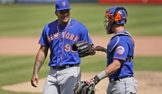 New York Mets starting pitcher Taijuan Walker, left, is congratulated by catcher James McCann as they head off the field after working the seventh inning of a baseball game against the St. Louis Cardinals Thursday, May 6, 2021, in St. Louis. (AP Photo/Jeff Roberson)