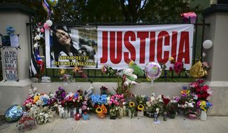 "Flowers, balloons and a poster with the Spanish word for ""justice"" is part of a growing makeshift memorial for Keishla Rodriguez whose lifeless body was found in a lagoon Saturday, at the entrance of where she lived in San Juan, Puerto Rico, Thursday, May 6, 2021. A federal judge on Monday ordered Puerto Rican boxer Felix Verdejo held without bail after he was charged with the death of Keishla Rodriguez and with intentionally killing the unborn child she was carrying. (AP Photo/Carlos Giusti)"