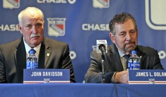 """FILE - John Davidson, left, and James Dolan, owner of the New York Rangers, participate in a news conference in New York, in this Wednesday, May 22, 2019, file photo. The New York Rangers have been fined $250,000 by the NHL for """"demeaning"""" public comments about head of player safety George Parros. Owner James Dolan on Wednesday, May 5, 2021, fired team president John Davidson and general manager Jeff Gorton with three games left in the season and turned those jobs over to former assistant Chris Drury. (AP Photo/Seth Wenig, File)"""