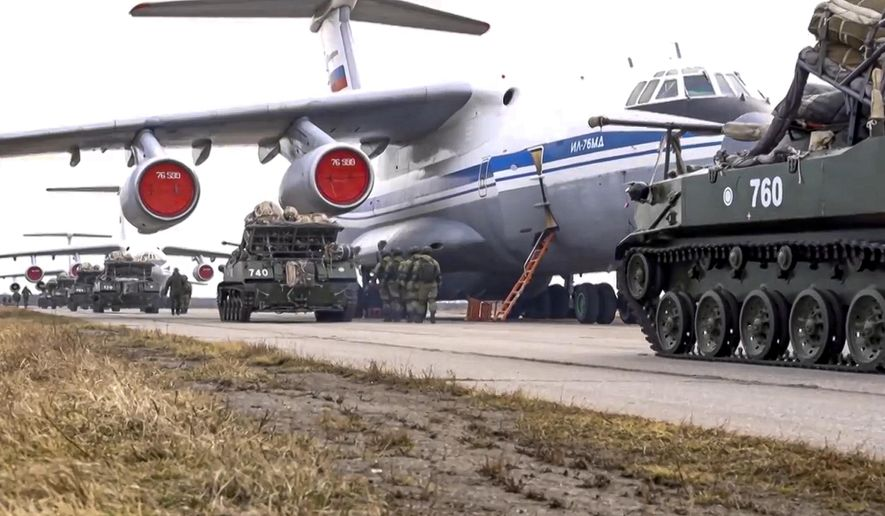 In this file photo released on Thursday, April 22, 2021, by Russian Defense Ministry Press Service, Russian military vehicles prepare to be loaded into a plane for airborne drills during maneuvers in Crimea. Russia, which claims its soldiers are not on the ground in eastern Ukraine, caused fears to soar this year by conducting massive military exercises of more than 300,000 soldiers near the border with Ukraine. Russia said late last month that it has pulled the forces back to their bases, but Ukraine saw the exercises as ominous. (Russian Defense Ministry Press Service via AP, File)