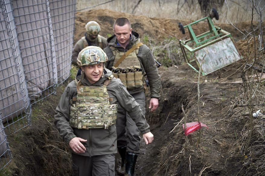 In this April 9, 2021, file photo, Ukrainian President Volodymyr Zelensky visits the war-hit Donbas region, eastern Ukraine. (Ukrainian Presidential Press Office via AP, File)