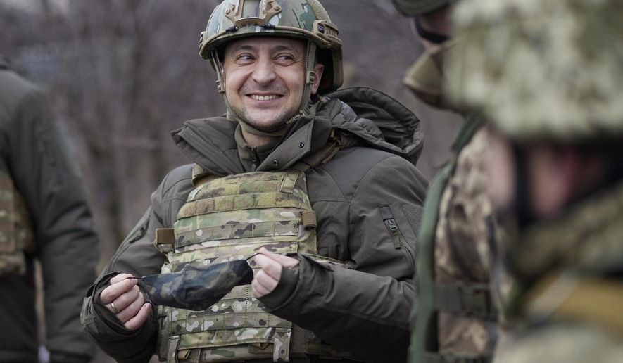 In this Thursday, Feb. 11, 2021, file photo, Ukrainian President Volodymyr Zelensky talks with servicemen as he visits the war-hit Donetsk region, eastern Ukraine. On the frontlines of the battle against Russia-backed separatists and in the halls of government in Kyiv, Ukrainians hold strong hopes for the visit of the U.S. Secretary of State — increased military aid and strong support for NATO membership among them. (Ukrainian Presidential Press Office via AP, File)