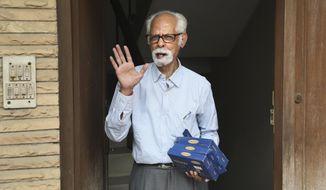 FILE - In this Nov. 8, 2020, file photo, Vice President Kamala Harris' maternal uncle, Balachandran Gopalan, talks to media outside his house, in New Delhi, India. (AP Photo/Manish Swarup, File)