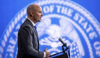 In this March 18, 2021, file photo, Utah Gov. Spencer Cox speaks during his monthly news conference in Salt Lake City. Cox said Thursday, May 6, 2021, he has no plans to renew the state's mask order for K-12 schools next fall, following months of mounting pressure from parents calling for the mandate's end. (Spenser Heaps/The Deseret News via AP, Pool, File)