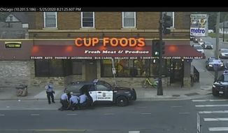 In this May 25, 2020, file image from surveillance video, Minneapolis police officers, from left, Tou Thao, Derek Chauvin, J. Alexander Kueng and Thomas Lane are seen attempting to take George Floyd into custody in Minneapolis, Minn. (Court TV via AP, Pool, File)