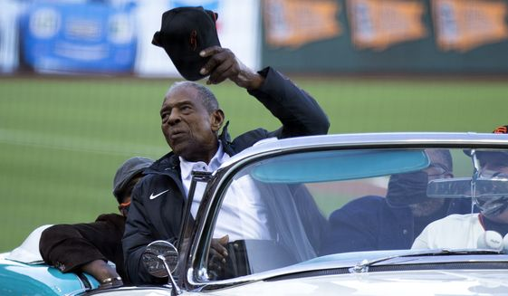 San Francisco Giants Hall of Fame outfielder Willie Mays waves to the crowd as the team honors him on the day after his 90th birthday, Friday, May 7, 2021, in San Francisco. (AP Photo/D. Ross Cameron)