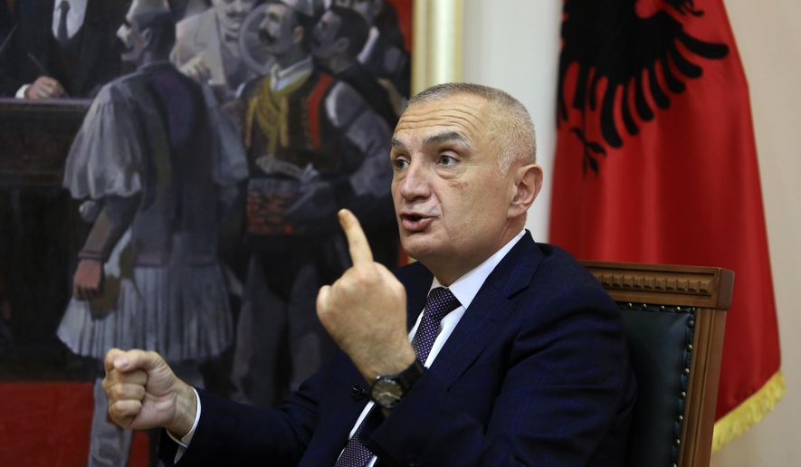 """Albanian President Ilir Meta speaks during an interview with the Associated Press in Tirana, Albania, Wednesday, April 21, 2021. Albania's president waded deep into the country's parliamentary election campaign Wednesday, accusing the left-wing government of running a """"kleptocratic regime"""" and bungling its pandemic response. In an interview with The Associated Press, Ilir Meta also said he would step down if Prime Minister Edi Rama's Socialists — who are leading the main opposition conservatives in opinion polls — win Sunday's vote. (AP Photo/Hektor Pustina)"""