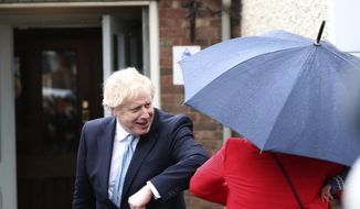 British Prime Minister Boris Johnson gives an elbow bump as he leaves after speaking to the media with Conservative Party candidate Jill Mortimer, not pictured, who won the Hartlepool by-election, at Hartlepool Marina, in Hartlepool, northeast England, Friday, May 7, 2021. (AP Photo/Scott Heppell)