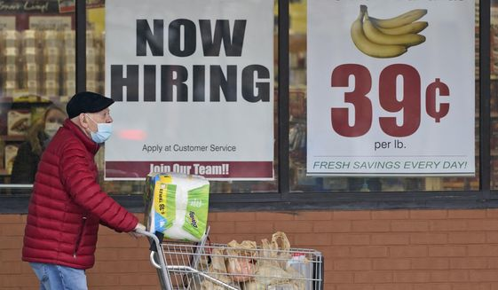 In this Friday, Jan. 8, 2021, file photo, a man walks out of a Marc's Store in Mayfield Heights, Ohio. (AP Photo/Tony Dejak, File)