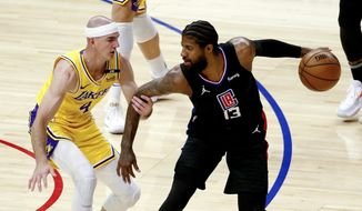 Los Angeles Clippers' Paul George (13) is defended by Los Angeles Lakers' Alex Caruso (4) during the first half of an NBA basketball game Thursday, May 6, 2021, in Los Angeles. (AP Photo/Ringo H.W. Chiu)