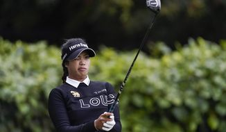 Patty Tavatanakit lines up her shot at the 10th tee during the second round of the LPGA's Hugel-Air Premia LA Open golf tournament at Wilshire Country Club Thursday, April 22, 2021, in Los Angeles. (AP Photo/Ashley Landis)