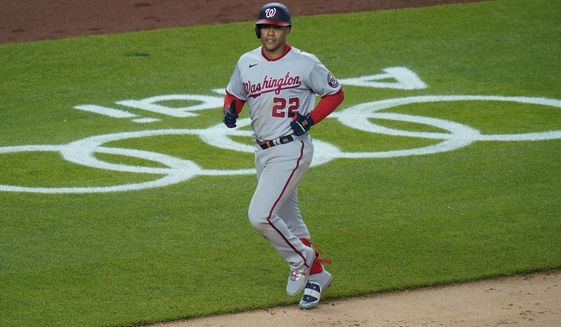 Washington Nationals' Juan Soto (22) runs the bases after hitting a two-run home run during the ninth inning of a baseball game against the New York Yankees, Friday, May 7, 2021, in New York. (AP Photo/Frank Franklin II)