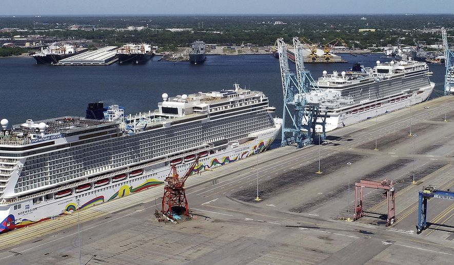 FILE - In this May 4, 2020 file photo, Norwegian cruise ships are docked at Portsmouth Marine Terminal in Portsmouth, Va. Norwegian Cruise Lines is threatening to skip Florida ports because of the governor's order banning businesses from requiring that customers be vaccinated against COVID-19. The company says Gov. Ron DeSantis' order conflicts with guidelines from federal health authorities that would let cruise ships sail in U.S. waters if passengers and crew members are vaccinated.  (Stephen M. Katz/The Virginian-Pilot via AP, File)