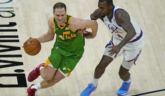 Denver Nuggets forward Paul Millsap (4) guards Utah Jazz forward Bojan Bogdanovic (44) during the first half of an NBA basketball game Friday, May 7, 2021, in Salt Lake City. (AP Photo/Rick Bowmer)