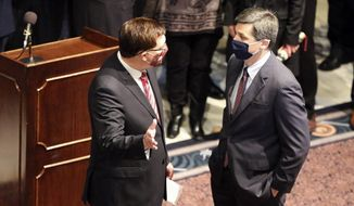 FILE - In this Jan. 27, 2021 file photo, South Carolina House Speaker Jay Lucas, left, and Senate Majority Leader Shane Massey, right, talk before a news conference in Columbia, S.C.  Lucas and Massey are both on a conference committee that will try to work on a compromise on a bill to reform state-owned utility Santee Cooper. (AP Photo/Jeffrey Collins, File).