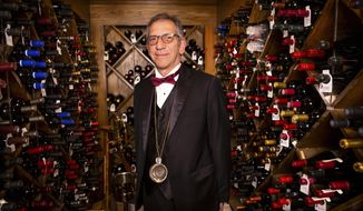 Jon Simmons, sommelier at Hugo's Cellar at the Four Queens for the past 37 years, poses for a portrait Thursday April 29, 2021 in Las Vegas. Simmons has been the man for 37 years. The Las Vegas Sun reports that as Las Vegas' current elder statesman of wine, Simmons is now pouring glasses for grandchildren of his original customers in the legendary nook of Old Vegas at the Four Queens. (Christopher DeVargas /Las Vegas Sun via AP)