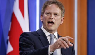 Britain's Transport Secretary Grant Shapps speaks about COVID-19 during a media briefing in Downing Street, London, Friday May 7, 2021. (Tolga Akmen/Pool via AP)