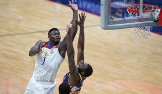 New Orleans Pelicans forward Zion Williamson (1) shoots against Golden State Warriors forward Draymond Green in the second half of an NBA basketball game in New Orleans, Tuesday, May 4, 2021. The Pelicans won 108-103. (AP Photo/Gerald Herbert)