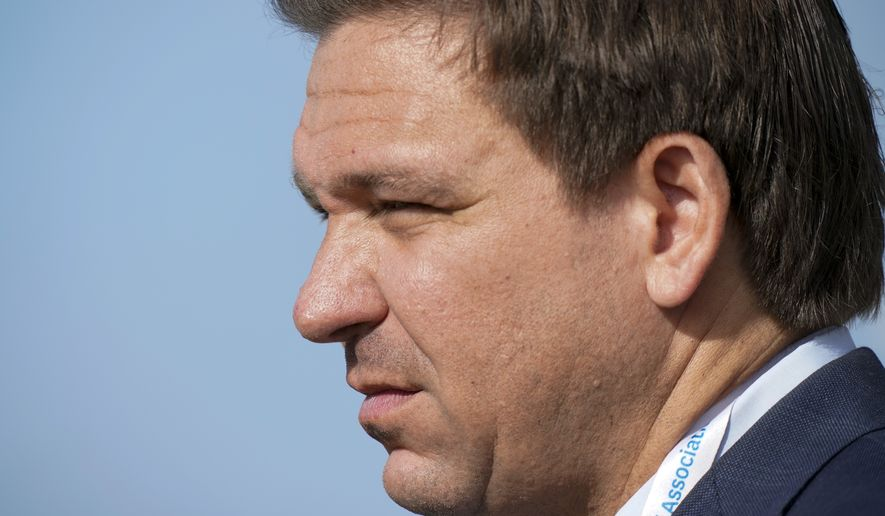 Gov. Ron DeSantis, of Florida, watches the foursome matches during the Walker Cup golf tournament at the Seminole Golf Club on Saturday, May 8, 2021, in Juno Beach, Fla. (AP Photo/Brynn Anderson) ** FILE **