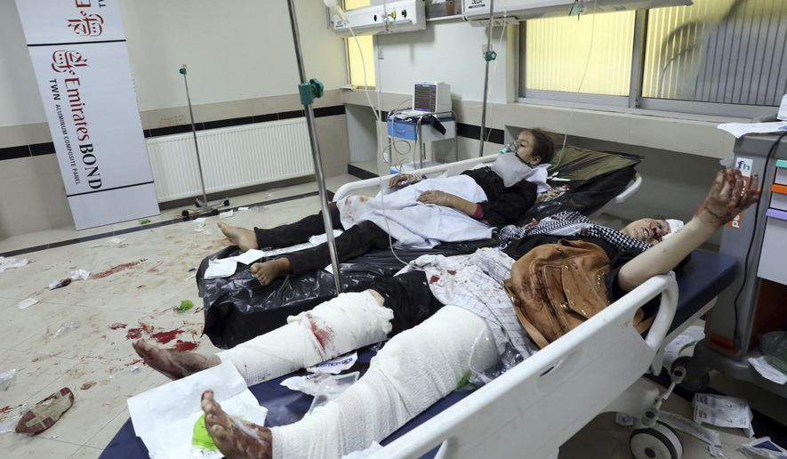 Afghan school students treated at a hospital after a bomb explosion near a school in west of Kabul, Afghanistan, Saturday, May 8, 2021. A bomb exploded near a school in west Kabul on Saturday, killing several, many them young students, Afghan government spokesmen said. (AP Photo/Rahmat Gul)