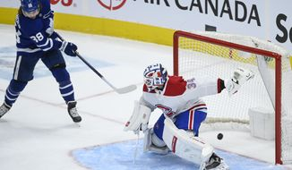 Toronto Maple Leafs forward William Nylander (88) scores past Montreal Canadiens goaltender Jake Allen (34) during the second period of an NHL hockey game Saturday, May 8, 2021, in Toronto. (Nathan Denette/The Canadian Press via AP)