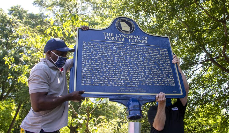 A historical marker that tells the story of the lynching of Porter Flournoy Turner is installed in Atlanta's Druid Hills community, Thursday, May 6, 2021. Porter Turner was lynched near the area in August 1945. (Alyssa Pointer/Atlanta Journal-Constitution via AP)