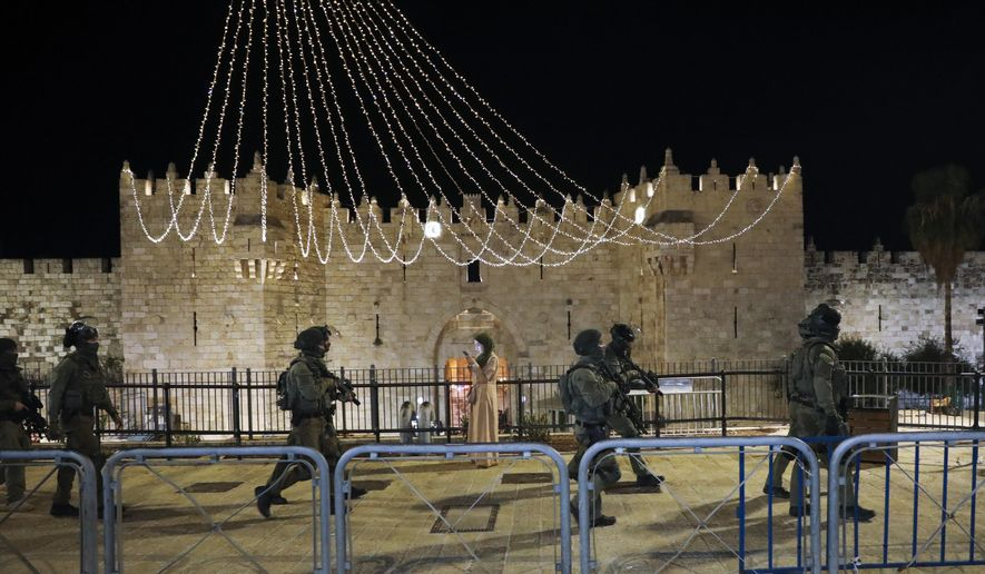 Israeli border police officers deploy during clashes with Palestinian protesters next to Damascus Gate in Jerusalem's old city, Friday, May 7. 2021. Palestinians protested over Israel's threatened eviction of dozens of Palestinians in the Sheikh Jarrah neighborhood in east Jerusalem, who have been embroiled in a long legal battle with Israeli settlers trying to acquire property in the neighborhood. (AP Photo/Mahmoud Illean)