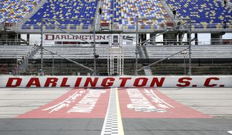 FILE - In this May 17, 2020, file photo, the grandstands are empty at Darlington Raceway before a NASCAR Cup Series auto race in Darlington, S.C. Darlington Raceway officials are excited about hosting the first of two scheduled NASCAR weekends, something the track hadn't featured since 2004. (AP Photo/Brynn Anderson, File)