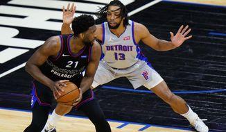 Philadelphia 76ers' Joel Embiid ,left, tries to get around Detroit Pistons' Jahlil Okafor during the first half of an NBA basketball game, Saturday, May 8, 2021, in Philadelphia. (AP Photo/Matt Slocum)