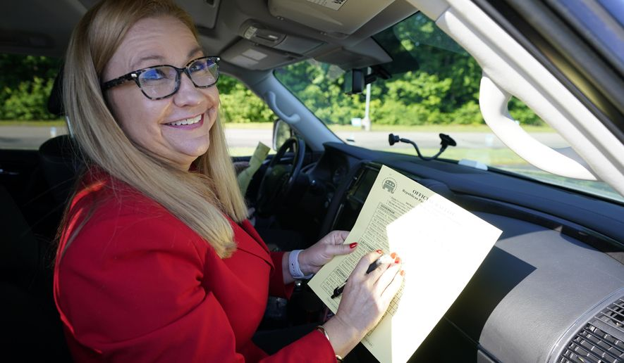 Republican gubernatorial candidate State Sen. Amanda Chase, fills out her ballot during a drive through GOP Convention vote in Chesterfield, Va., Saturday, May 8, 2021. (AP Photo/Steve Helber)