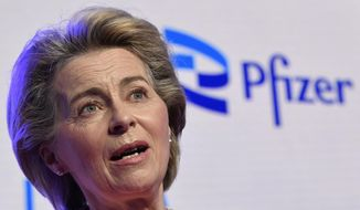 """FILE - In this Friday, April 23, 2021 file photo, European Commission President Ursula von der Leyen makes a statement during an official visit to the Pfizer pharmaceutical company in Puurs, Belgium. The European Union has cemented its support for Pfizer-BioNTech and its novel COVID-19 vaccine technology by agreeing to a massive contract extension for a potential 1.8 billion doses through 2023. EU Commission President Ursula von der Leyen tweeted that her office """"has just approved a contract for a guaranteed 900 million doses (+900 million options).""""  (John Thys, Pool via AP, File)"""