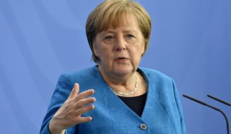 German Chancellor Angela Merkel attends a press conference after the informal EU summit and the EU-China summit in Berlin, Germany, Saturday, May 8, 2021. Merkel reiterated her stance that the shortage of vaccines worldwide would not be solved by a waiver of patents, as suggested by U.S. President Biden. (John MacDougall/Pool Photo via AP)