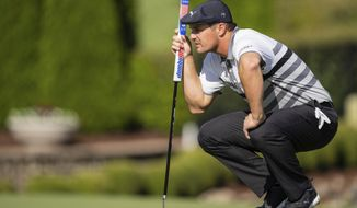 Bryson DeChambeau lines up his putt on the seventh hole during the third round of the Wells Fargo Championship golf tournament at Quail Hollow, Saturday, May 8, 2021, in Charlotte, N.C. (AP Photo/Jacob Kupferman)