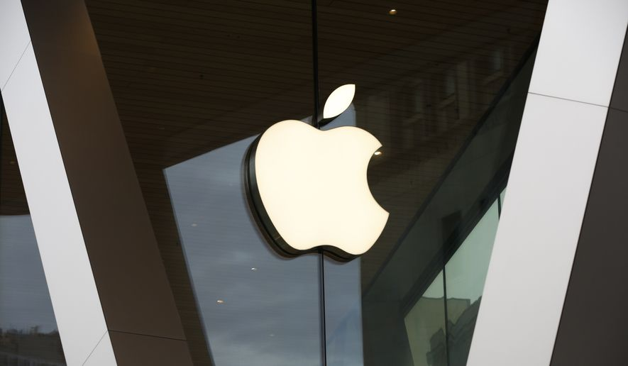 In this Saturday, March 14, 2020, file photo, an Apple logo adorns the facade of the downtown Brooklyn Apple store in New York. (AP Photo/Kathy Willens, File)