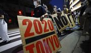 People who are against the Tokyo 2020 Olympics set to open in July, march around Tokyo's National Stadium during an anti-Olympics demonstration Sunday, May 9, 2021, (AP Photo/Eugene Hoshiko)