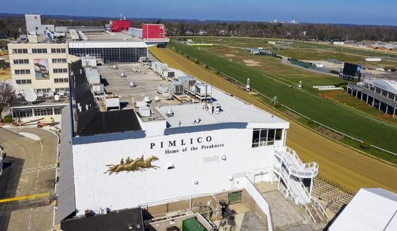 In this March 26, 2020, file photo, tractors groom the racing surface at the Pimlico Race Course in Baltimore. Pimlico, which opened in 1870, is set to be rebuilt over the next two-plus years. (AP Photo/Steve Helber, File) **FILE**