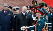 Russian President Vladimir Putin, center, and Tajikistan's President Emomali Rakhmon, left, attend a wreath-laying ceremony at the Tomb of the Unknown Soldier after the Victory Day military parade in Moscow, Russia, Sunday, May 9, 2021, marking the 76th anniversary of the end of World War II in Europe. (Mikhail Metzel, Sputnik, Kremlin Pool Photo via AP)