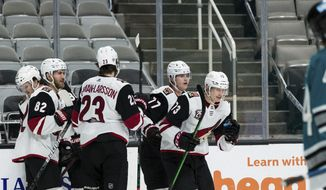 Arizona Coyotes right wing Jan Jenik (73) celebrates with teammates after scoring a goal against the San Jose Sharks during the second period of an NHL hockey game in San Jose, Calif., Saturday, May 8, 2021. (AP Photo/John Hefti)