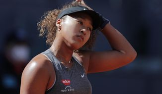 Naomi Osaka of Japan reacts during her match against Karolina Muchova of the Czech Republic during their match at the Madrid Open tennis tournament in Madrid, Spain, Sunday, May 2, 2021. (AP Photo/Paul White)