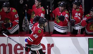 Chicago Blackhawks left wing Brandon Hagel (38) celebrates with teammates after scoring during the first period of the team's NHL hockey game against the Dallas Stars in Chicago, Sunday, May 9, 2021. (AP Photo/Nam Y. Huh)